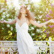 Young beauty woman with opened arms outdoors — Stock Photo