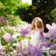 Young woman in blooming garden — Stock Photo #27086959