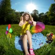 Happiness young woman at a picnic in the par thumbs up — Stock Photo #27087065