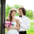Stock Photo: Young bride and groom in love
