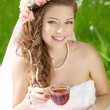 Young bride in a wreath of flowers — Stock Photo