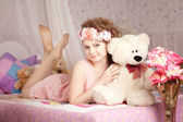 Beautiful woman with a toy bear — Stock Photo