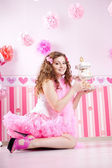 Sexy young woman in pink room — Stock Photo
