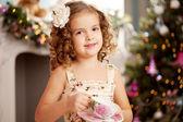 Little sweet girl with tea — Stock Photo