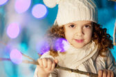 Little winter girl with rabbit — Stok fotoğraf