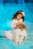 Little winter girl with rabbit — Stock Photo