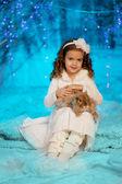 Little winter girl with rabbit — Stock Photo