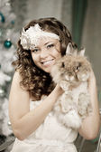 Fashion woman in luxury interior with bunny — Stock Photo