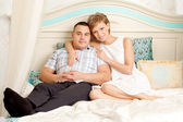 Couple in love hugs at home — Stock Photo