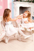 Lovely two girls playing at home — Stock Photo