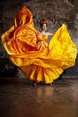 Lady in flying silk dress — Stock Photo