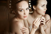 Woman with creative make-up of pearls — Stock Photo