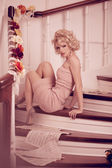 Splendid woman on staircase — Stock Photo