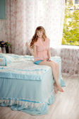 Cute young girl in the children's bedroom — Stock Photo
