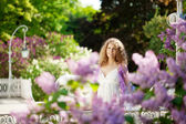Young woman in blooming garden — Stock Photo