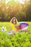 Happiness young woman at a picnic in the park — Stock Photo