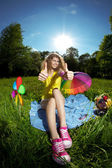 Happiness young woman at a picnic in the par thumbs up — Stock Photo