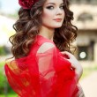 Beautiful woman in a bright red dress — Stok fotoğraf