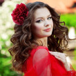 Beautiful woman in a bright red dress — Stockfoto