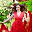 Beautiful woman in a bright red dress — Foto de Stock