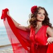 Stock Photo: Beautiful woman in a bright red dress