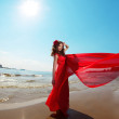 Beautiful woman in a bright red dress — Stock Photo
