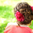 Beautiful woman with a flower in the hairstyle — Foto de Stock