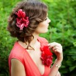 Beautiful womwith flower in hairstyle — Stock fotografie #31004879