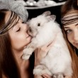 Two beautiful stylish girls with a rabbit — Stock Photo