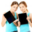 Two smiling women holding tablet computer — Stock Photo