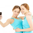 Wo women make the photo to mobile phone — Stock Photo