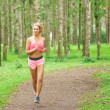 Woman sports, running in the park — Stock Photo