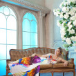 Luxury woman in fashionable dress in rich interior — Foto de Stock