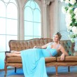 Luxury woman in fashionable dress in rich interior — Foto Stock