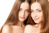 Beauty portrait of two beautiful young women — Stock Photo
