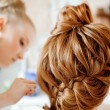 Stock Photo: Hair stylist makes bride before wedding