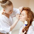 Stock Photo: Stylist makes makeup bride on wedding day