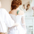 Beautiful bride wears dress by stylist — Stock Photo