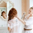 Hair stylist makes the bride on the wedding day — Stock Photo #38545013