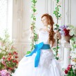 Beauty bride in luxurious interior with flowers — Stock Photo #38545041