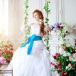 Beauty bride in luxurious interior with flowers — Zdjęcie stockowe #38545045