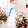 Beauty bride in luxurious interior with flowers — Stock Photo #38545069