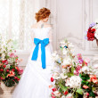 Beauty bride in luxurious interior with flowers — Stock Photo #38545101