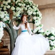 Beauty bride in luxurious interior with flowers — Stock Photo #38545131