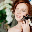 Beauty bride in luxurious interior with flowers — Stock Photo #38545177