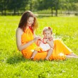 Stock Photo: Beauty Mom and baby outdoors. Happy family playing in nature. Mo