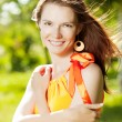 Stock Photo: Beauty young woman on nature in the park. Wind in the hair