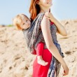 Stock Photo: Beauty woman with a baby in a sling. Mom and baby. Mother and ch