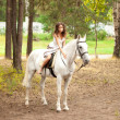 Young woman on a horse. Horseback rider, woman riding horse — Stock Photo #38545433