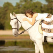Beautiful woman on a horse. Horseback rider, woman riding horse — Stock Photo